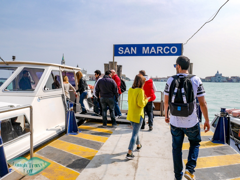 getting on boat for three island tour Venice Italy - laugh travel eat