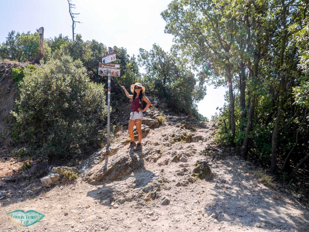wing pointing at signs to hiking trail on our hike to portovenere liguria italy | Laugh Travel Eat