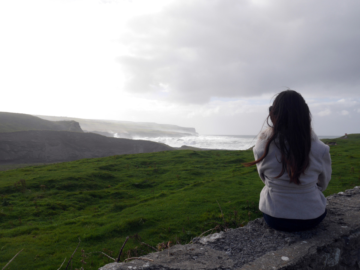 Me admiring the high wave crashing at the magnificent cliff of Moher| Laugh Travel Eat