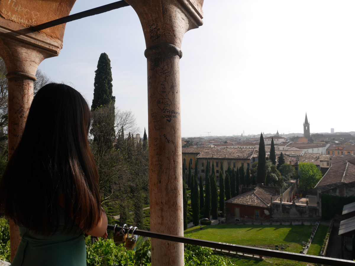 Me looking out to a paranomic view of Verona at Giordan Giusti| Laugh Travel Eat