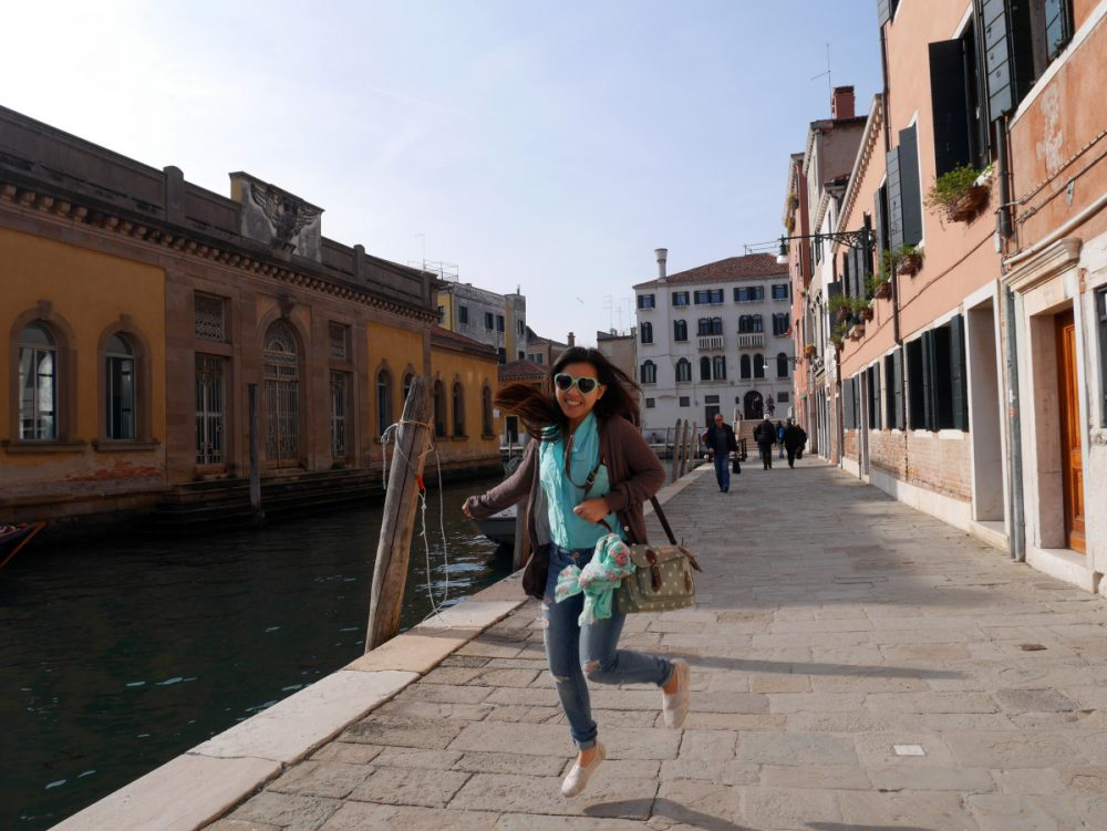 Me getting excited and jumping along a beautiful canal in Venice, Italy| Laugh Travel Eat