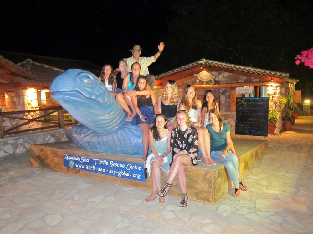 The volunteers taking a photo with founder Yannis on the new sea turtle statue| Laugh Travel Eat