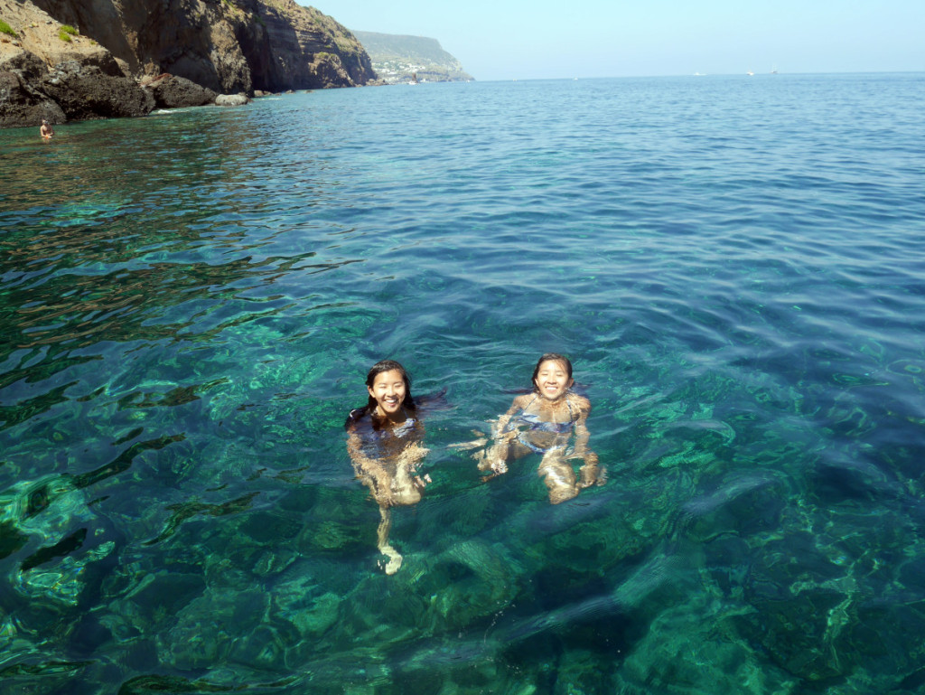 my sister and I swimming in the clear blue water at Lipari| Laugh Travel Eat