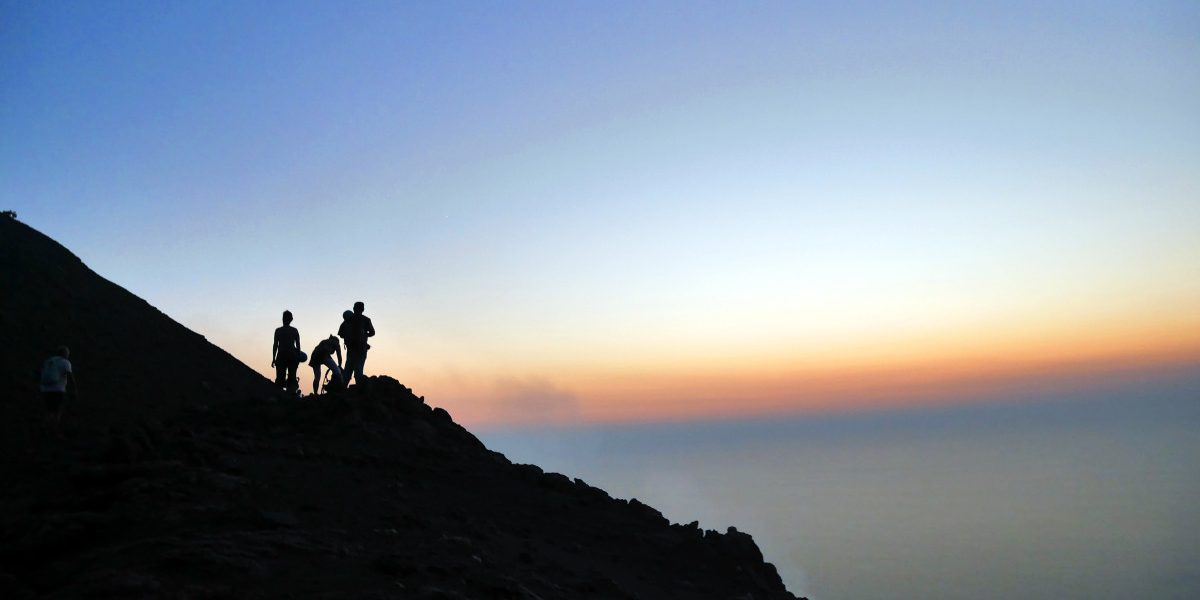 View of sunset, smoke and other hikers from Stromboli | Laugh Travel Eat