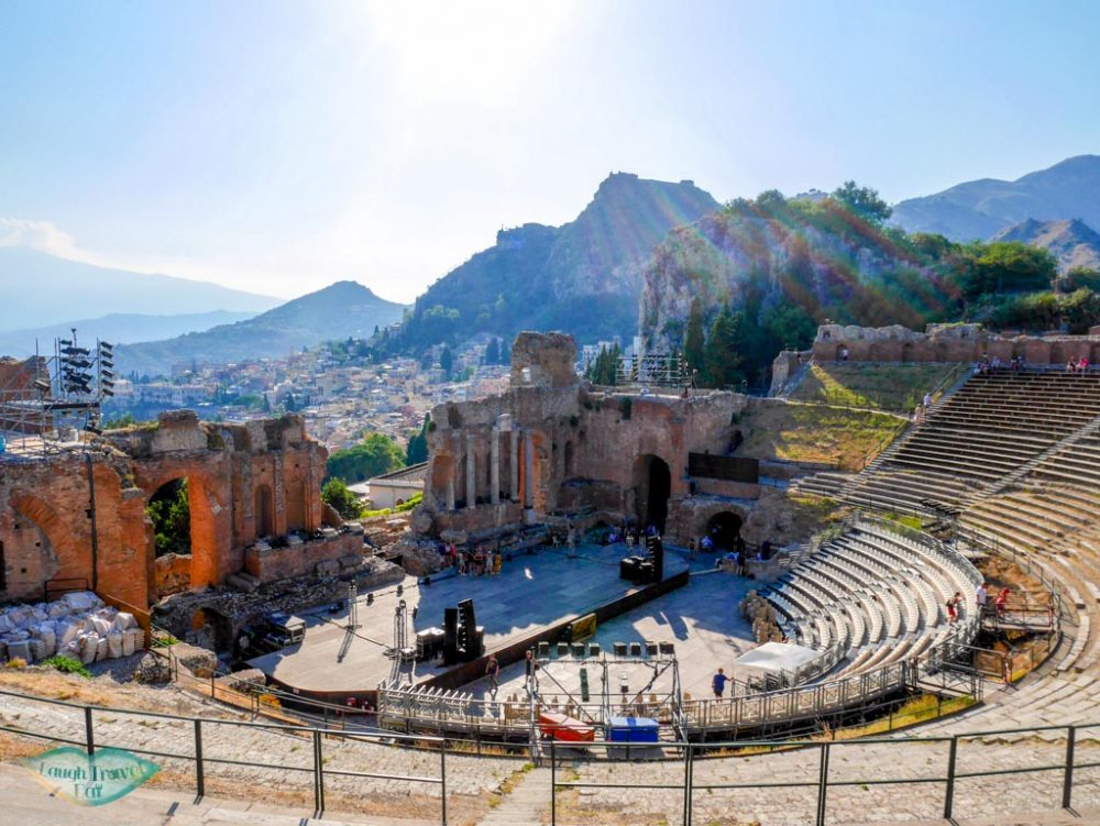 From the top of the Ancient Theater in Taormina, you get a good view of the theater, city and the mountains afar | Laugh Travel Eat