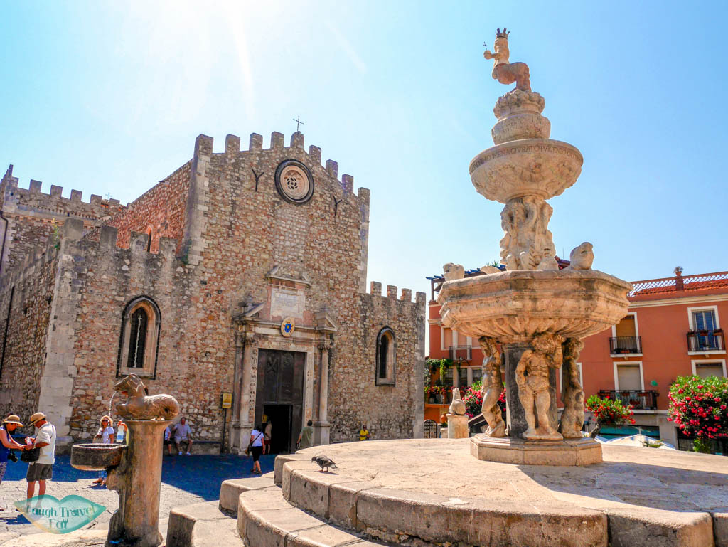 Square with a beautiful drinking fountain in front of the Duomo of Taormina | Laugh Travel Eat