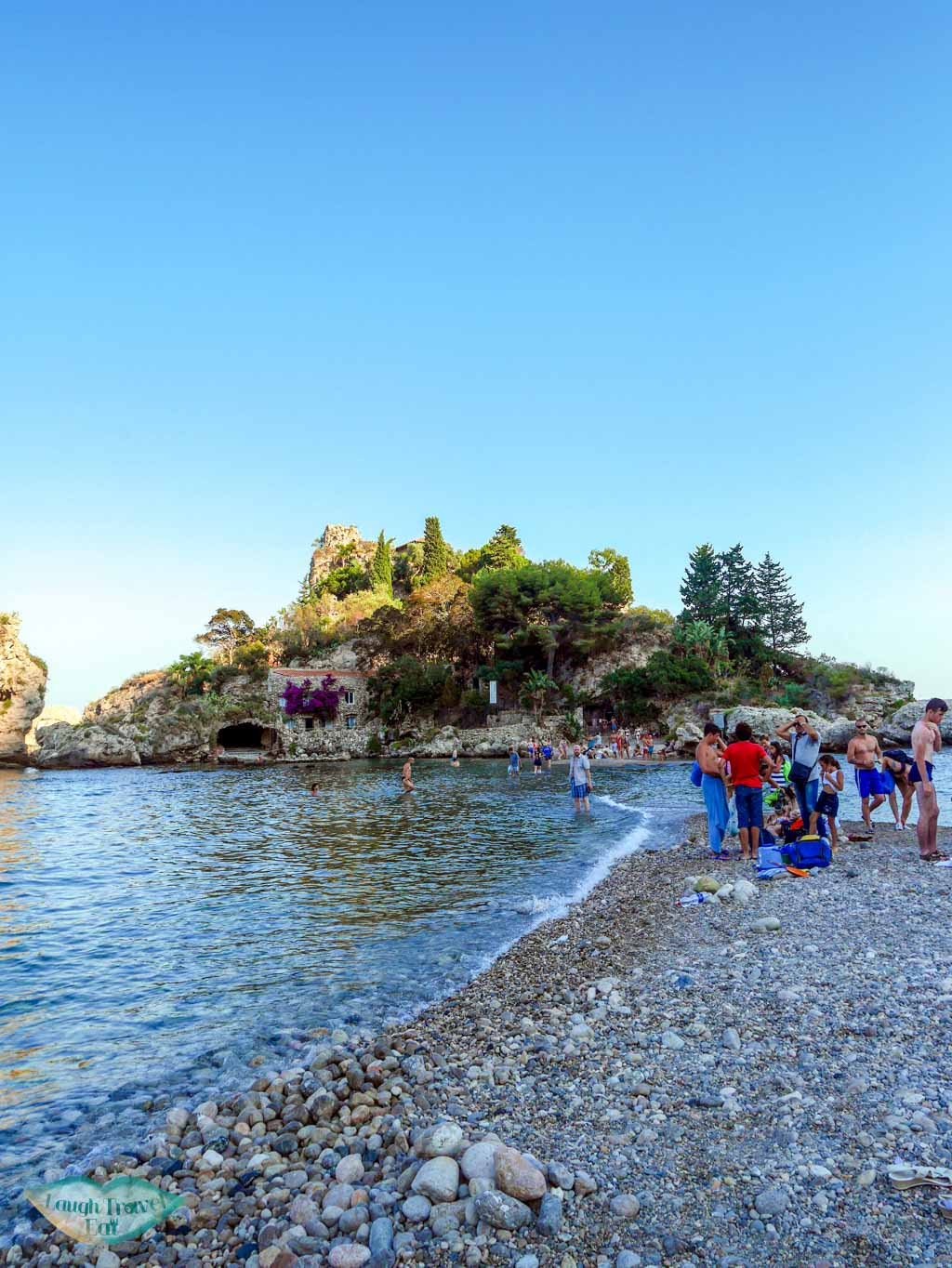 The narrow strand of sea that acts as a passage way from the beach at Taormina to Isola Bella | Laugh Travel Eat