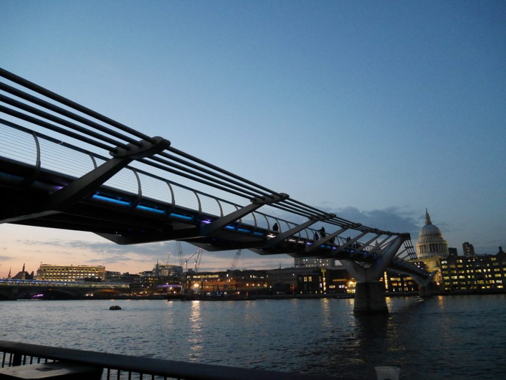 The Millennium Bridge across the River Thames in London at twilight | Laugh Travel Eat