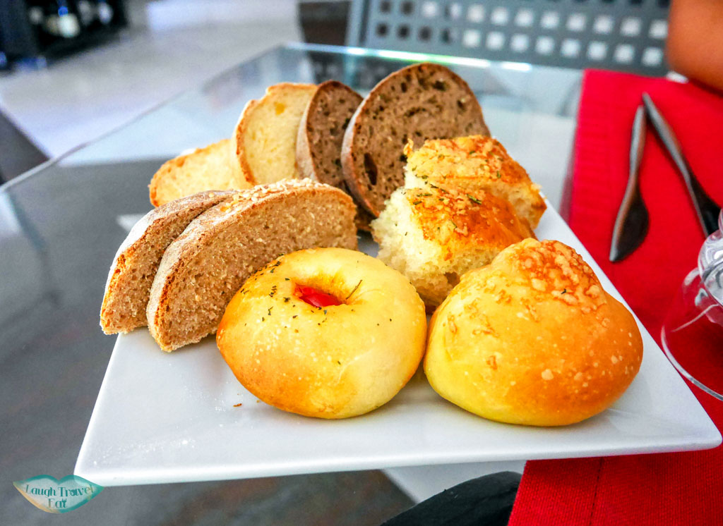 big plate of complimentary mixed bread platter with our meal at Andreas Ristorante, Taormina | Laugh Travel Eat