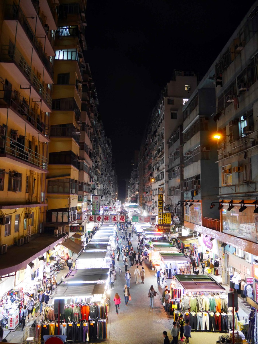 Fa Yuen Street at night, lined on both side with street vendors and clothing stores | Laugh Travel Eat