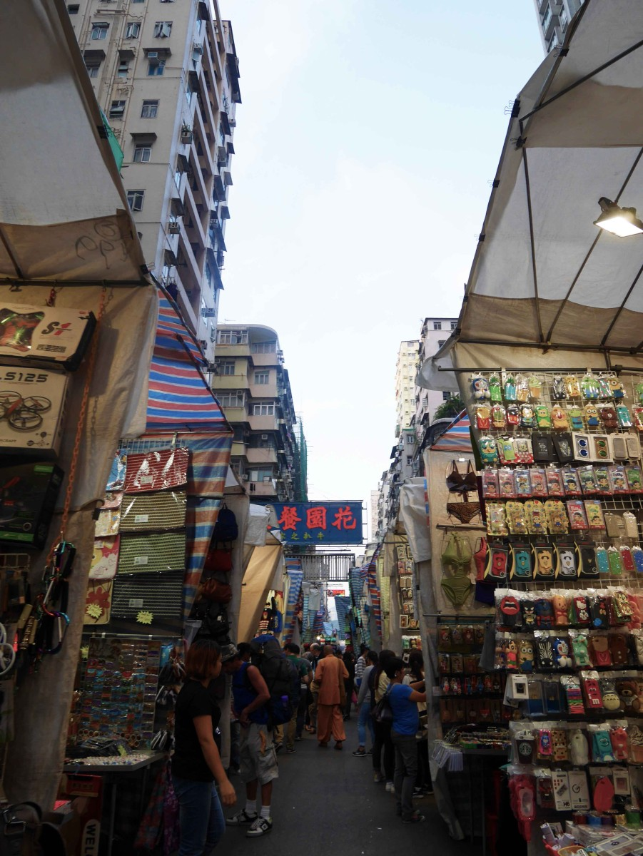Famous Ladies Market in Mong Kok, lined on both side with vendors selling knick-knack and souvenirs | Laugh Travel Eat