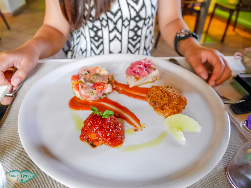 assorted starters artistically arranged on a plate at FlaM osteria in Palermo | Laugh Travel Eat