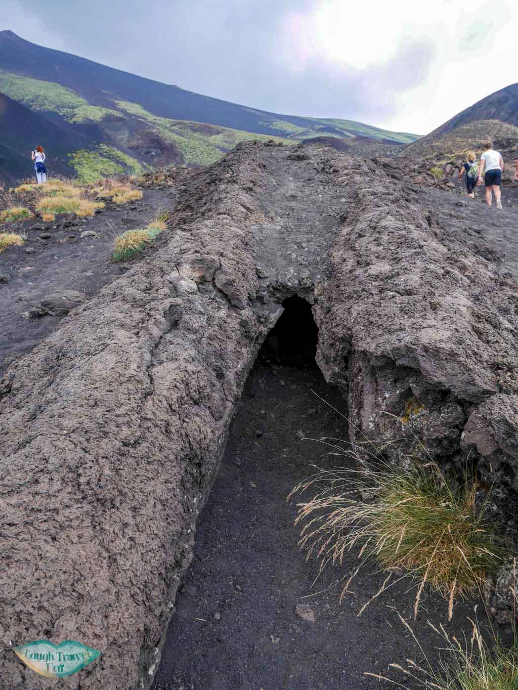Entrance of a small lava tube amidst the lava field on Mount Etna, Catania, Sicily | Laugh Travel Eat