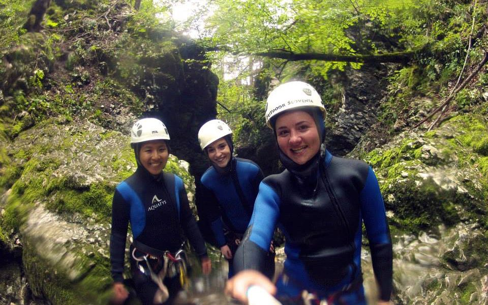 Canyoning shot of me and 2 girls in our wet suit and safety helmet | Laugh Travel Eat