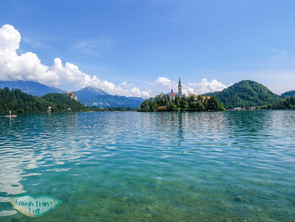 Bled island surrounded by the turquoise lake water | Laugh Travel Eat