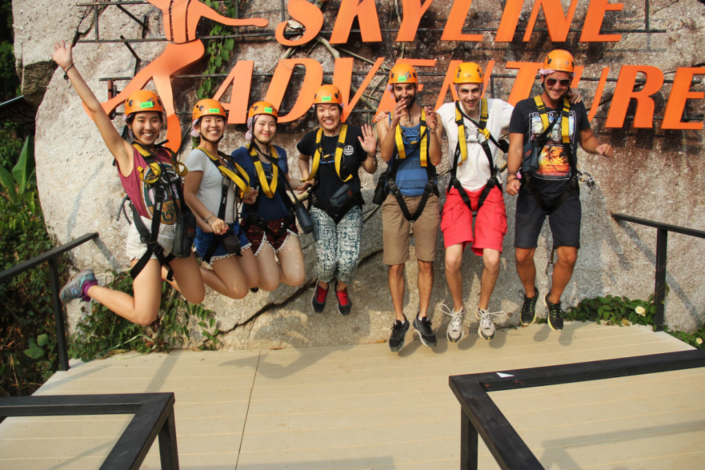 Jumping in front of the logo after our zip lining experience at Skyline Adventure, Chiang Mai | Laugh Travel Eat