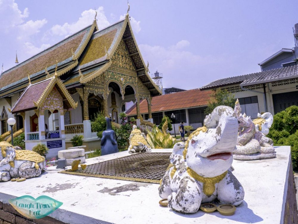The new viharn, with a cute elephant adorning the small fountain in front, Wat Chiang Man, Chiang Mai, Thailand | Laugh Travel Eat