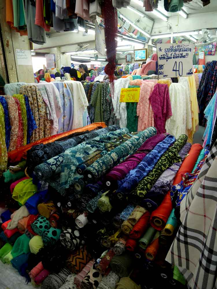 Elephant print and various colourful fabric on sale, Warorot Market, Chiang Mai, Thailand | Laugh Travel Eat