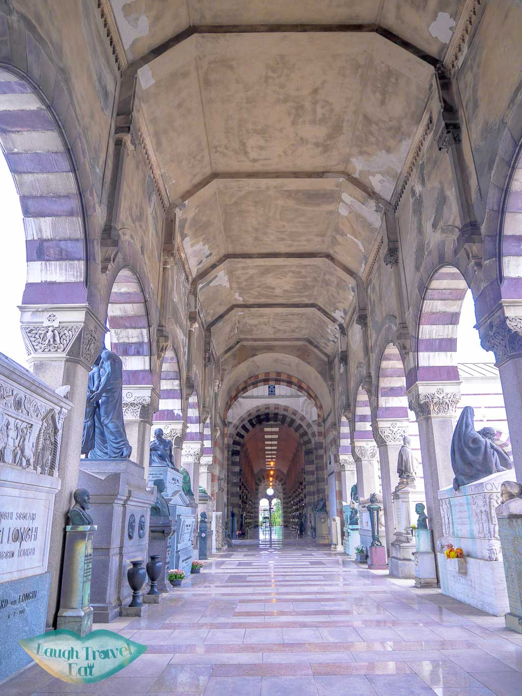 One of the galleries-corridor of Monumental Cemetery (Cimitero Monumentale), Milan, Italy - Laugh Travel Eat