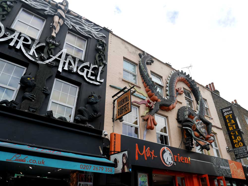 The road that leads from Camden Town Station to the market are full of quirky buildings with awesome statues, Camden Town, London, UK | Laugh Travel Eat