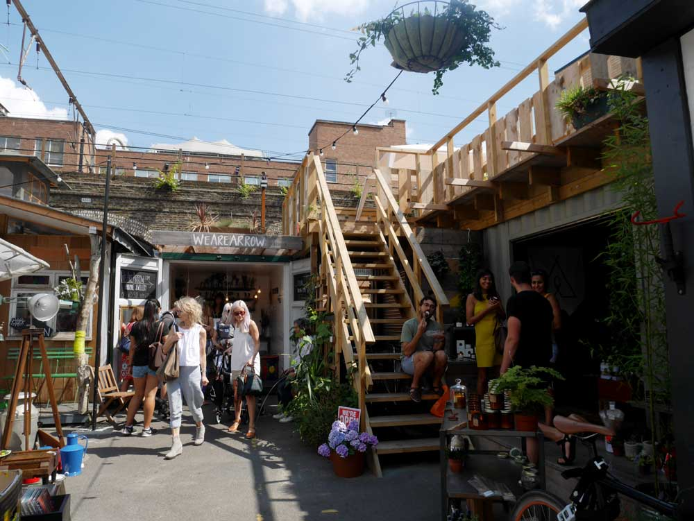 One of the many smaller markets in the area around Broadway Market, such a cool wooden structure!, East London, UK | Laugh Travel Eat