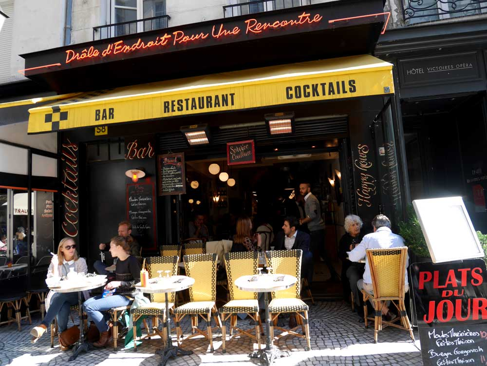 The outdoor seating of Parisian Cafe | Laugh Travel Eat