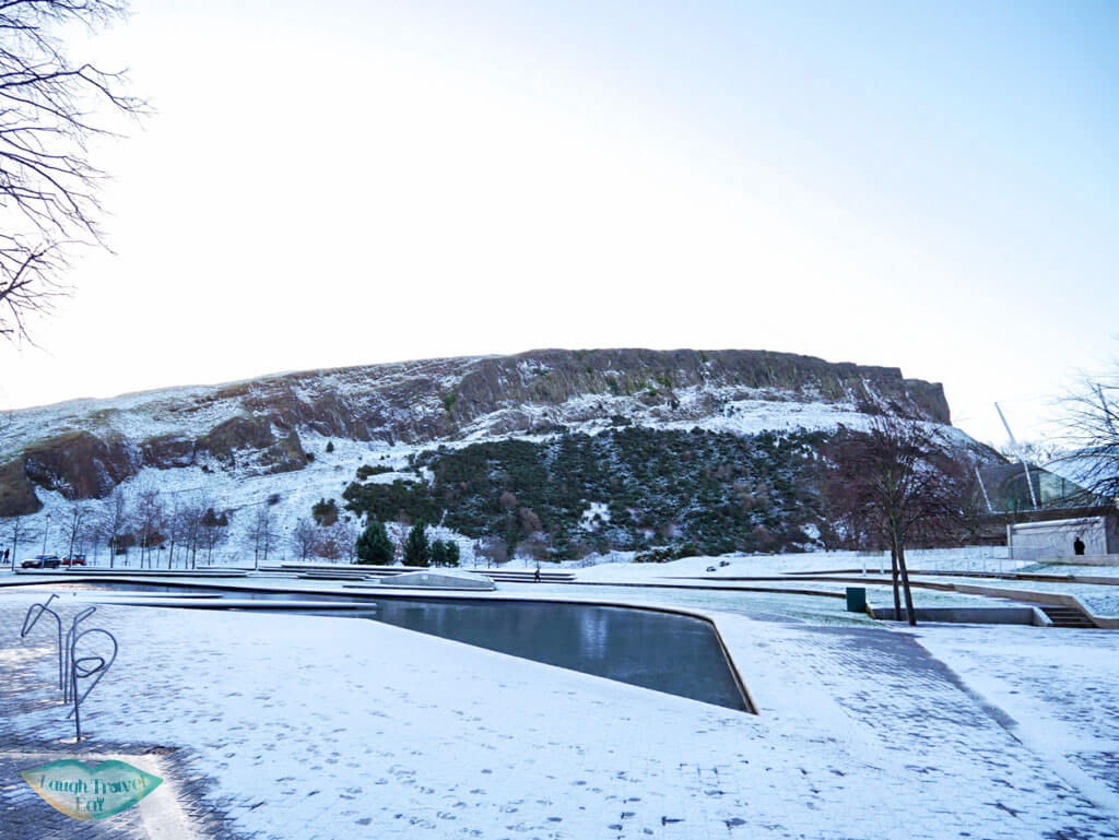 Arthur's Seat from the side in snow in Edinburgh, Scotland - Laugh Travel Eat