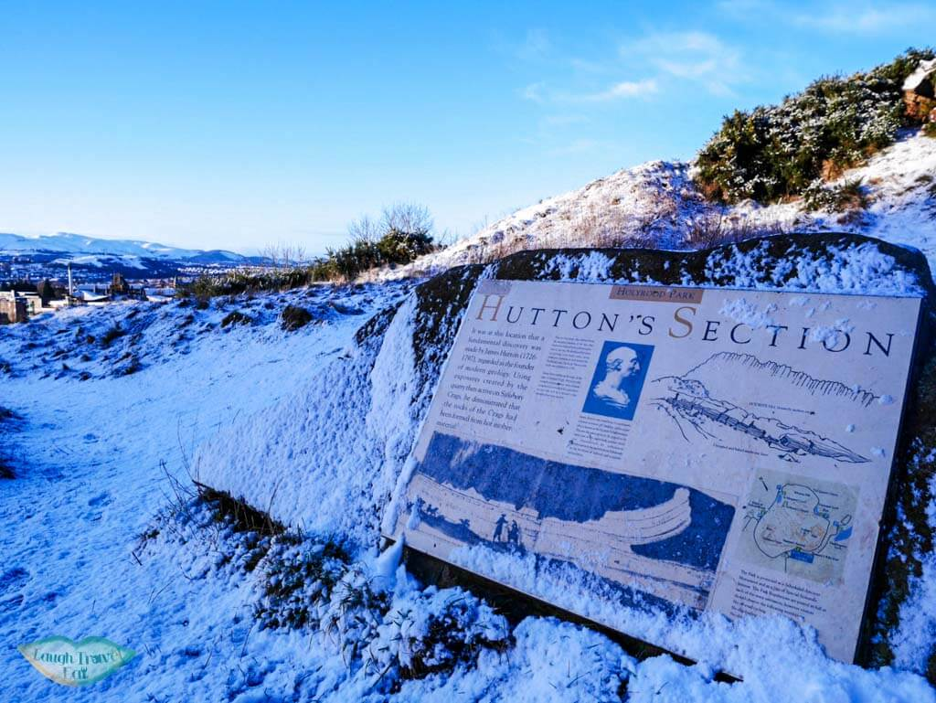 Sign marking where Hutton section is covered in snow in Edinburgh, Scotland - Laugh Travel Eat