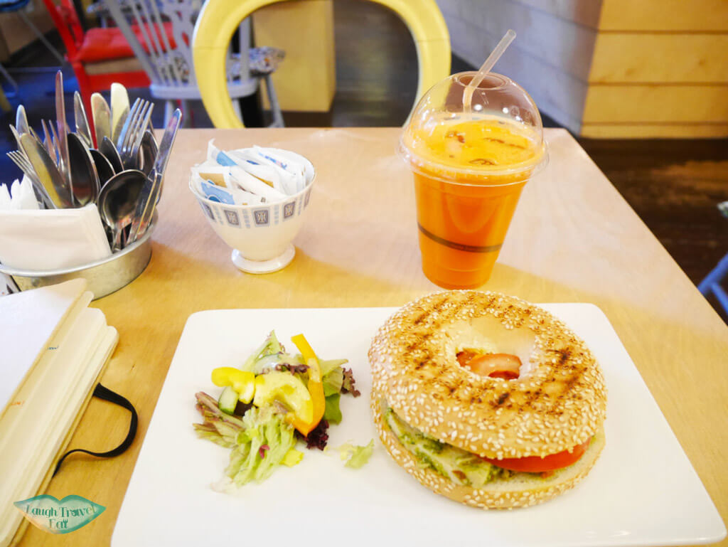 Sun-dried tomato with chicken bagel, coupled with carrot juice at Hula Juice Bar, Edinburgh - Laugh Travel Eat