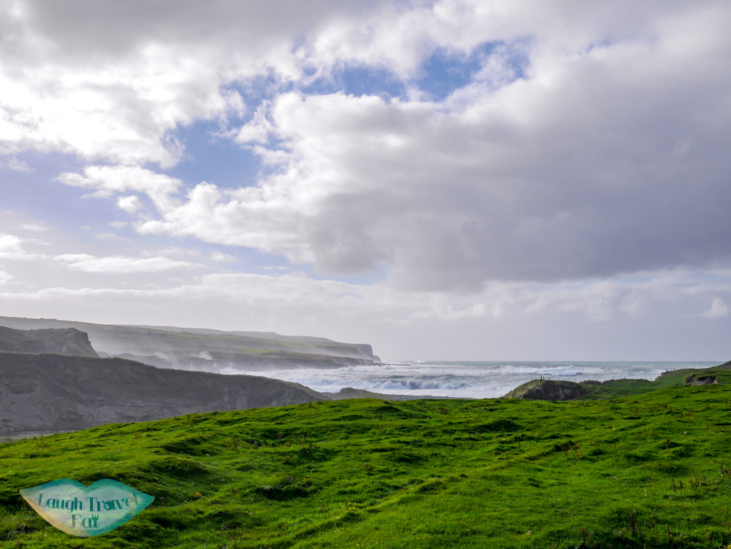 Wave-crashing-onto-the-Cliff-of-Moher-rail-tour-dublin-Ireland-Laugh-Travel-Eat