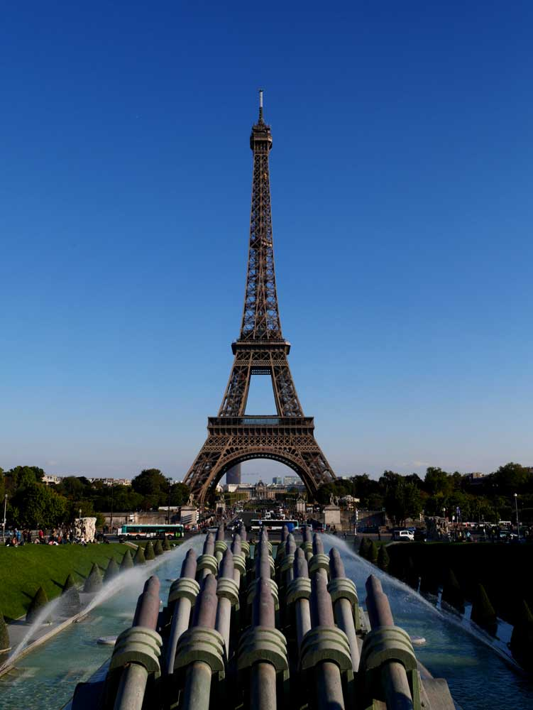 Eiffel tower viewed from the back of the Garden of Trocadero with the Fountain of Warsaw | Laugh Travel Eat