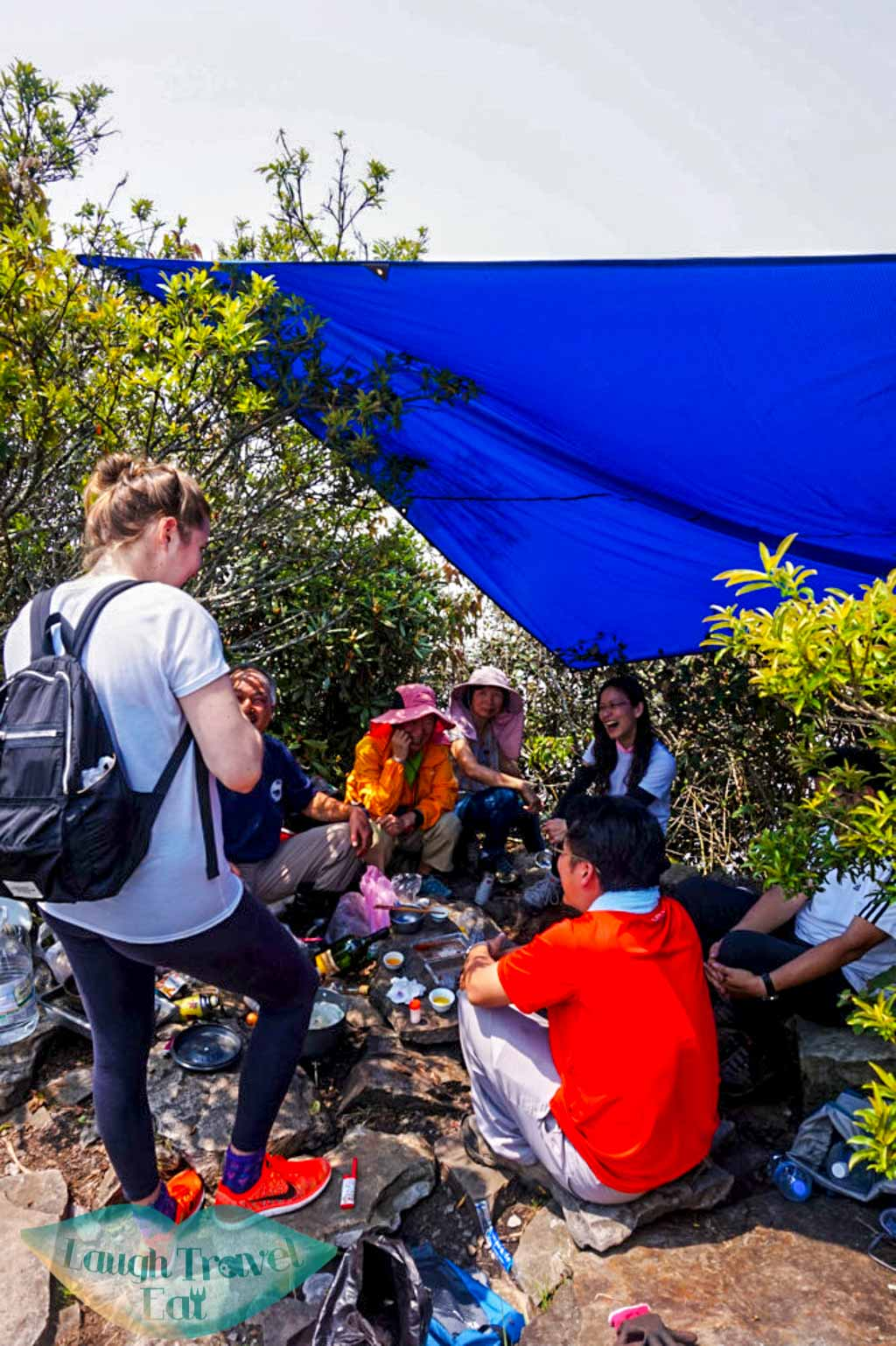 Regular hikers cooking and drinking with a cover set up for shade at Yuan Zui Mountain in Dasyueshan National Forest Recreational Area, Taichung - Laugh Travel Eat