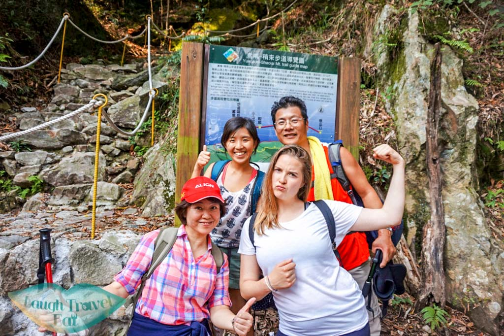 Triumphant pose in front of finishing line after hike up to Yuan Zui Mountain in Dasyueshan National Forest Recreational Area, Taichung - Laugh Travel Eat