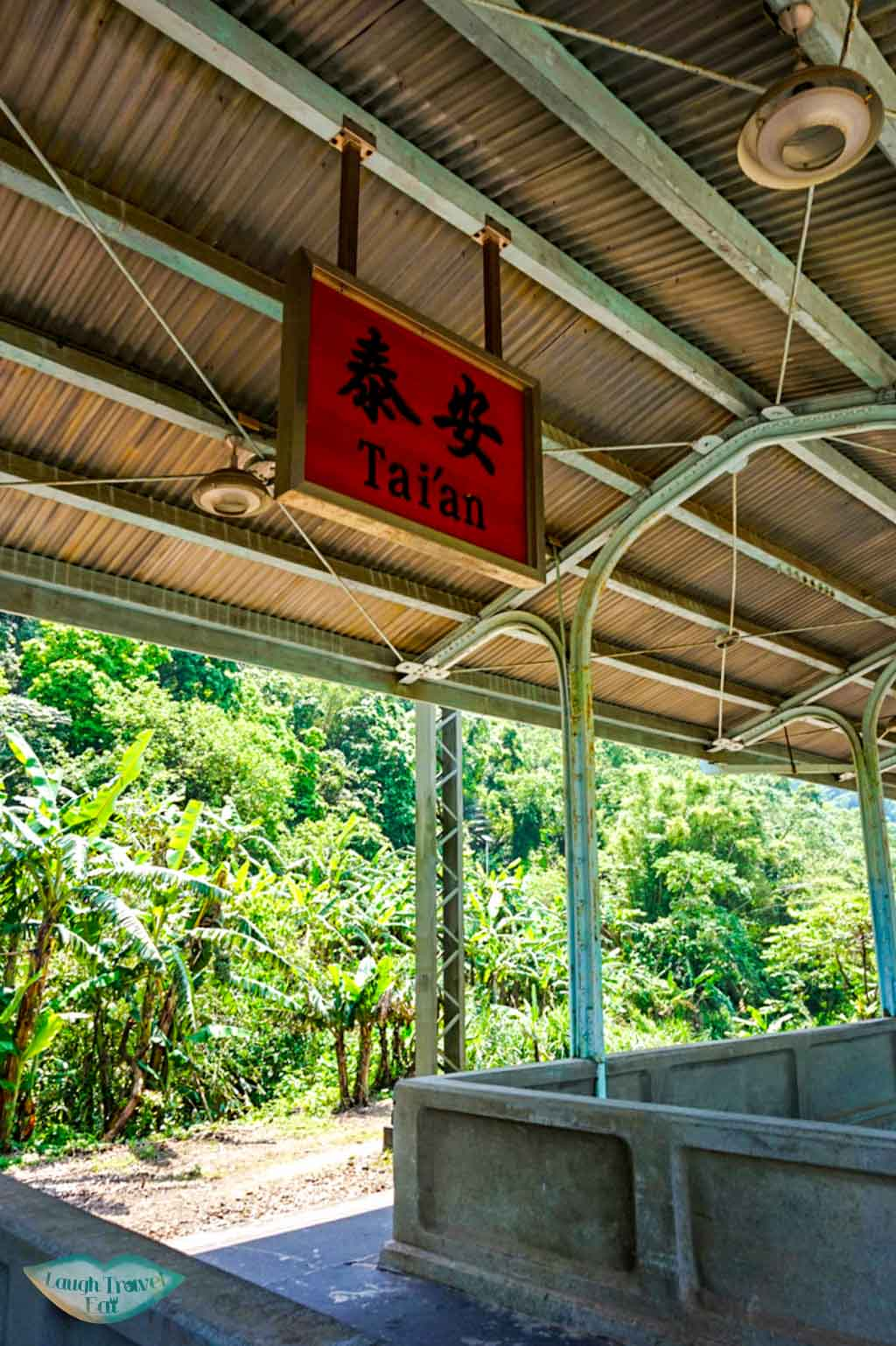 Wooden Tia'an station sign hanging on the platform Taichung Taiwan - Laugh Travel Eat