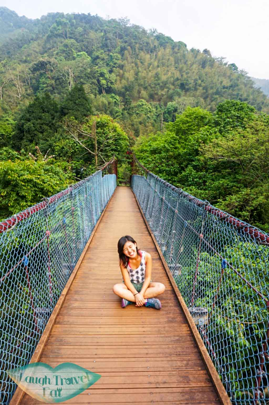 posing on the empty hanging bridge in Dasyueshan National Forest Recreational Area, Taichung - Laugh Travel Eat