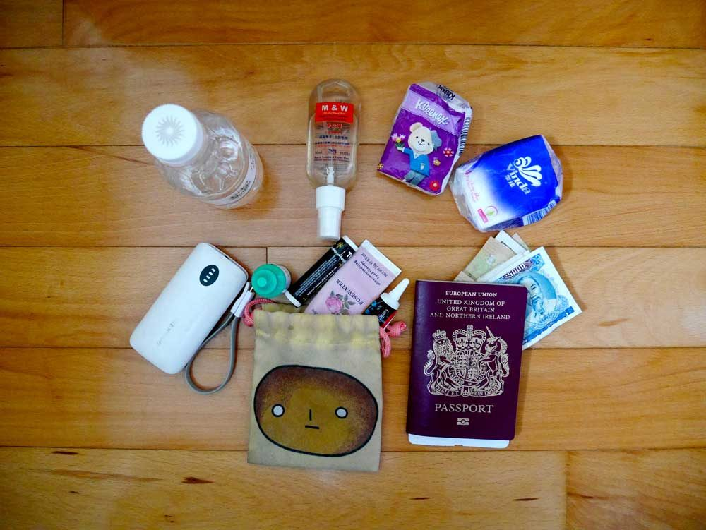 5 things that should be in your travel day bag flat lay | Laugh Travel Eat
