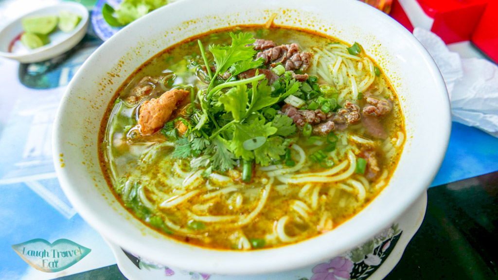 Eating Hue Beef noodles at one of the local stalls off the street, Hue, Vietnam - Laugh Travel Eat
