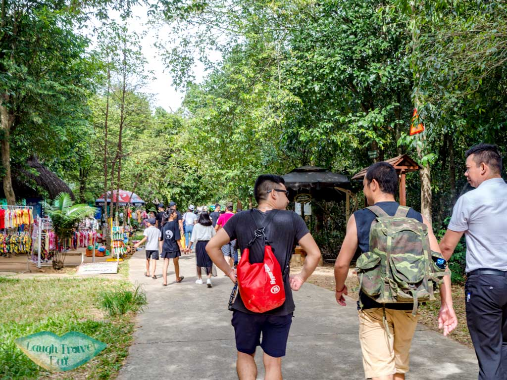walking to paradise cave phong nha vietnam - laugh travel eat