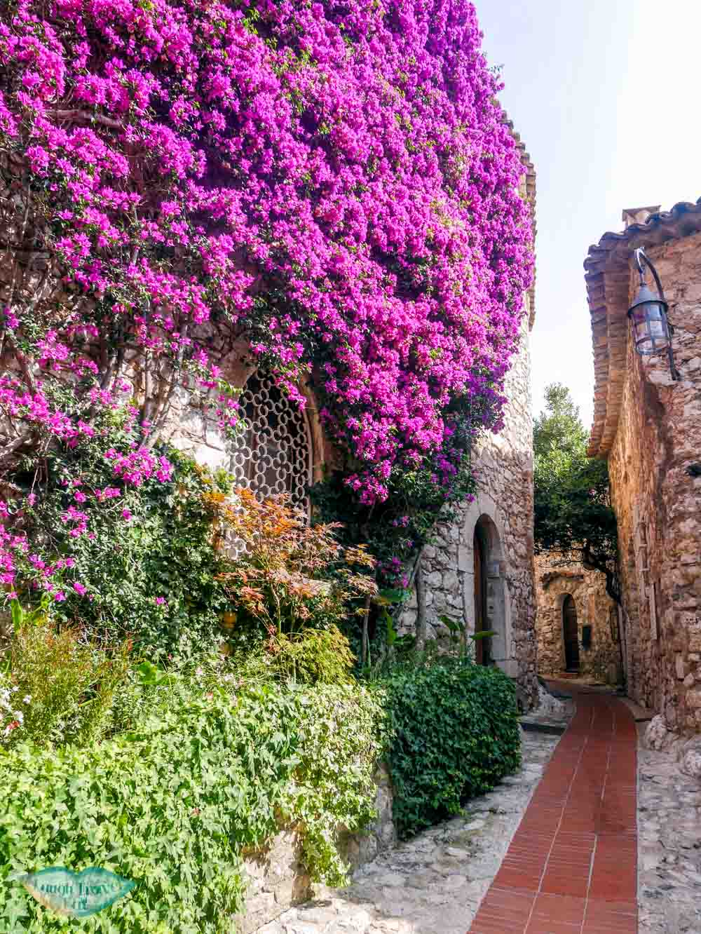 flower covered brick house eze south of france | Laugh Travel Eat