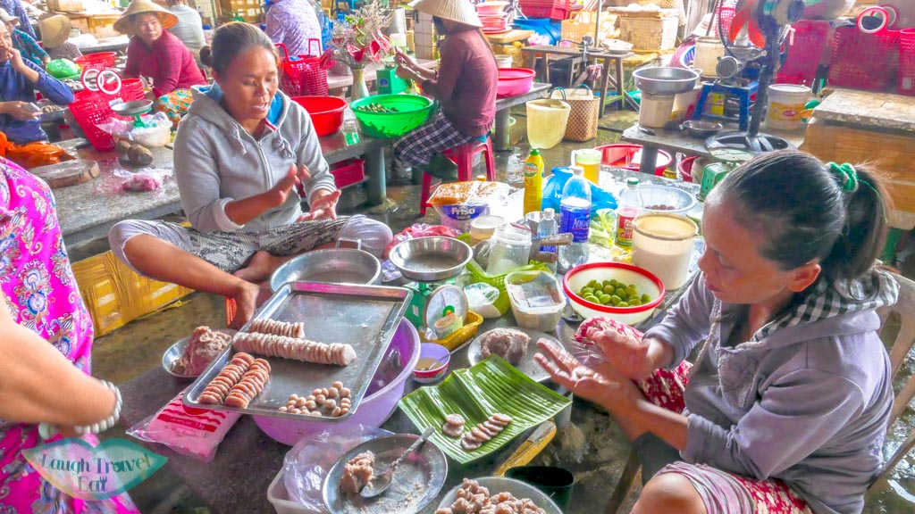 ladies at work in central market, Hoi An, Vietnam - Laugh Travel Eat