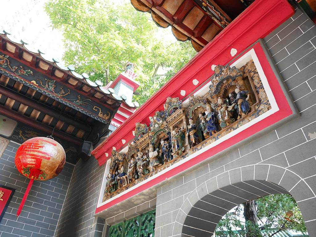Shek Wan pottery on the walls of Hau WOng Temple, Kowloon Wall City, Hong Kong | Laugh Travel Eat