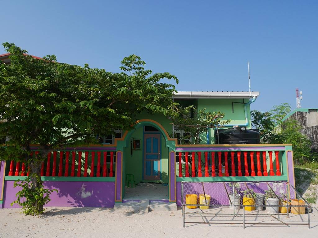 Green house with red fence, Gaafaru, Maldives | Laugh Travel Eat