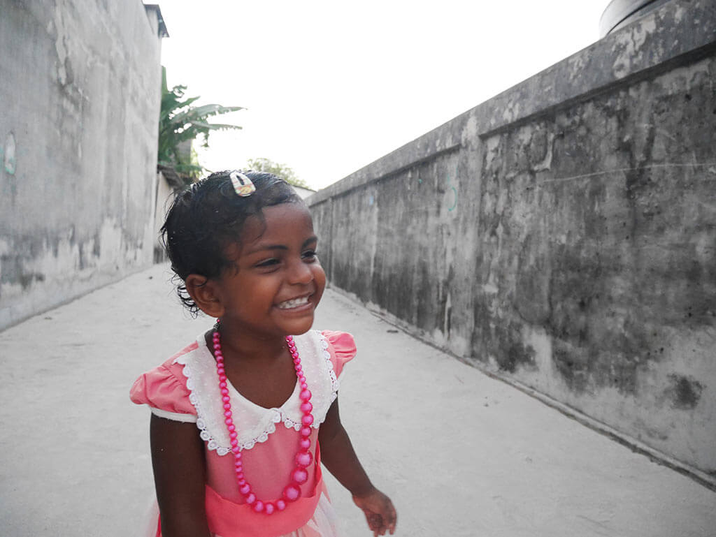 smiling girl, Gaafaru, Maldives | Laugh Travel Eat