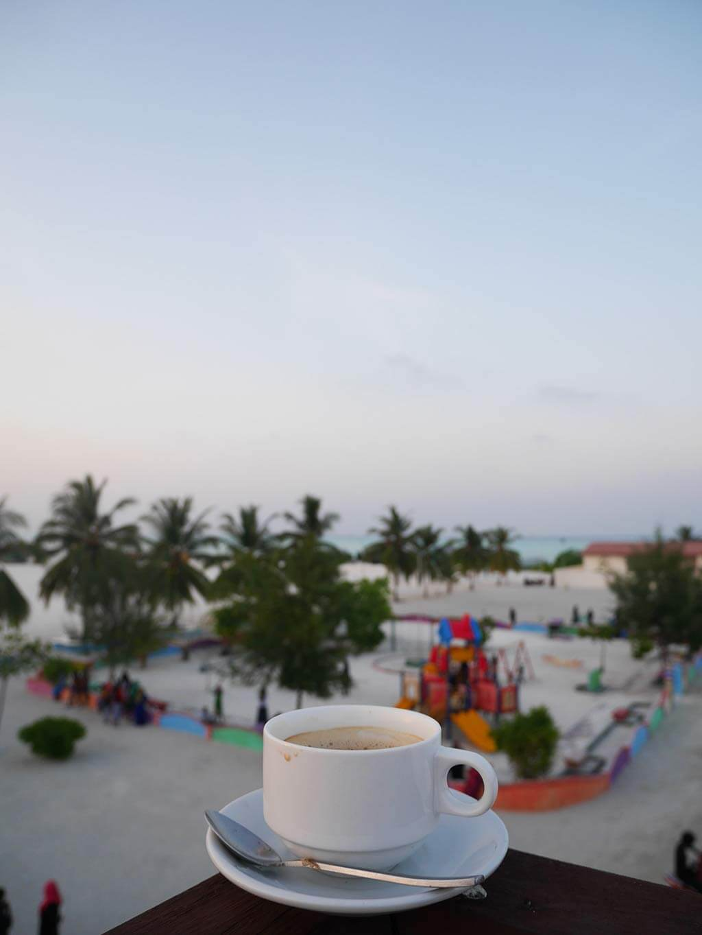 Coffee on top of island deck overlooking children's playground, Gaafaru, Maldives | Laugh Travel Eat