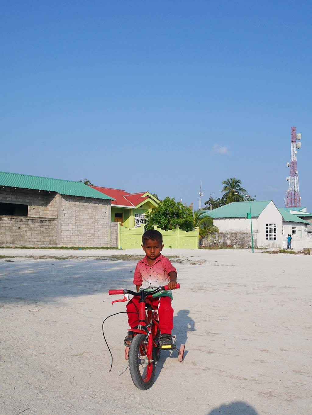 kid on a bicycle, Gaafaru, Maldives | Laugh Travel Eat