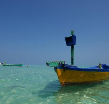 Wooden fishing boat on the bikini beach of Gaafaru, Maldives | Laugh Travel Eat