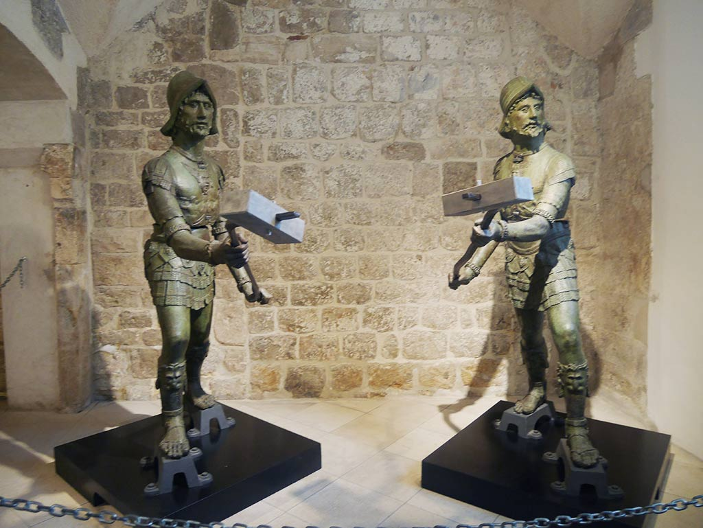 bronze twin statues for bell tower in rectors palace dubrovnik, croatia | Laugh Travel Eat