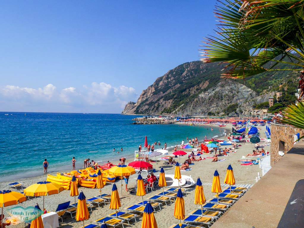 The organised sun beds and umbrella at the beach of Monterosso| Laugh Travel Eat