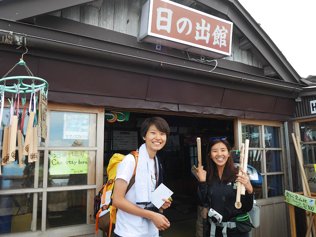 getting wooden stick stamps on at Mount Fuji huts, Japan | Laugh Travel Eat