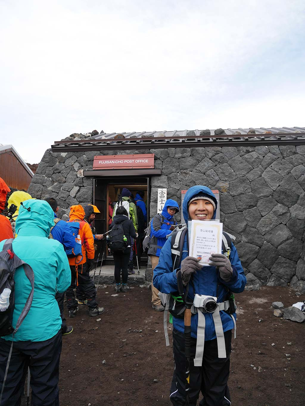 Getting hiking certificate at post office on Mount Fuji summit, Japan | Laugh Travel Eat